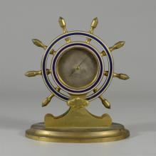 Brass ships wheel barometer, dial marked