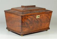 Mahogany sarcophagus form sewing box, interior with a fitted removable tray containing 9 spools of thread, with 7 covered compartmen...