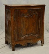Walnut French Provincial single door side cabinet, 18th c, raised panel shaped panel in door, some replaced bottom boards, 39 1/4