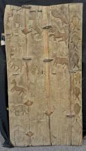 Primitive animal carved hardwood plank door, joined with handwrought iron clips, handwrought iron hinges, 58 3/4