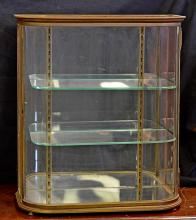 Brass framed curio cabinet, bow front, mirrored back, glass shelves, hinged door, original knob, circa 1900, 25 1/2