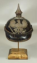 Imperial German leather pickelhaube, M1895, with green cloth clip on cover, generally excellent