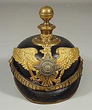 Imperial German leather artillery officer's pickelhaube, c 1880-97, scaled chin strap, generally excellent, brass rim on visor a lit..
