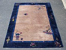 Peking Chinese Carpet, open café au lait field (some knots showing) bird and floral border, selvedge worn, 10' x 13'5