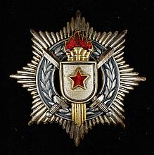 Soviet military medal with crossed sabres over 5 torches on a wreath, all on an 8 pointed star background, 2 1/2