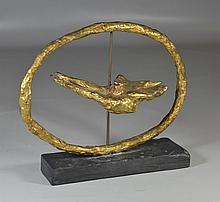 """Gerard Koch, French (1926-2014), gilt bronze oval sculpture with revolving bird, signed Koch, dated 1964, on black slate base, 13"""" w..."""