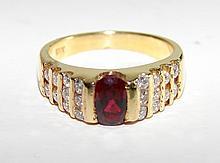 18K Yellow Gold Oval Cut Garnet Ladies Ring.