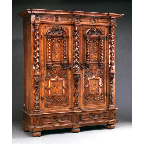 A German Baroque Walnut and Marquetry Armoire, Early 18th Century