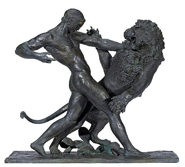 A fine French patinated bronze lost wax casting of a man and lion in combat