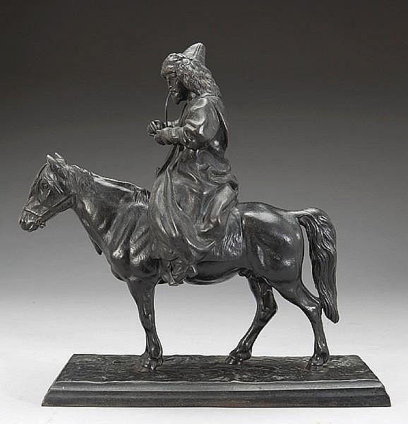 A Russian cast iron figure of a Kirgiz on horseback smoking a pipe