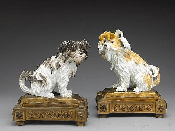 A pair of German porcelain gilt bronze mounted models of Bolognese terriers