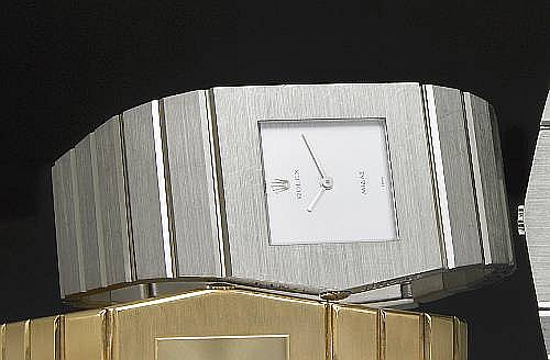 Rolex. A fine and unusual 18k white gold left-handed asymmetrical bracelet watch