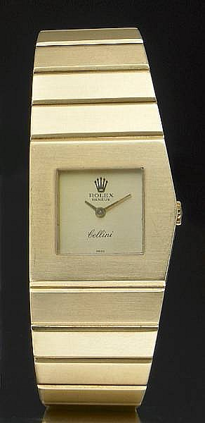 Rolex. A fine and unusual ladies 18k gold asymmetrical bracelet watch