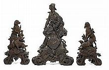 An impressive and imposing Black Forest carved lindenwood clock g
