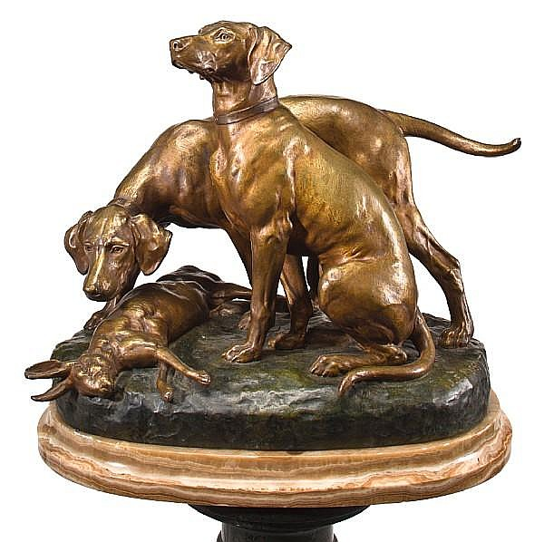 Jules Edmond Masson (French, 1871-1932) Two hounds and a rabbit height 18 in. (45.8 cm.) on an onyx base set on a verde antico marble pedestal overall height 63 in. (160 cm.)