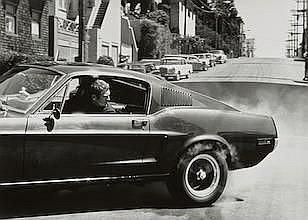 BARRY FEINSTEIN (1931-2011) Steve McQueen, Burning Rubber, Bullitt Car
