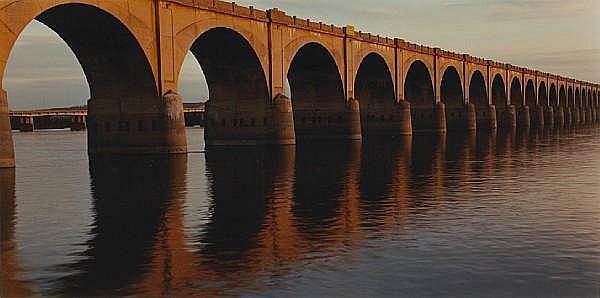 John Pfahl (American, born 1939); Evening Light on Railroad Viaduct, Harrisburg, PA, from Susquehanna series;