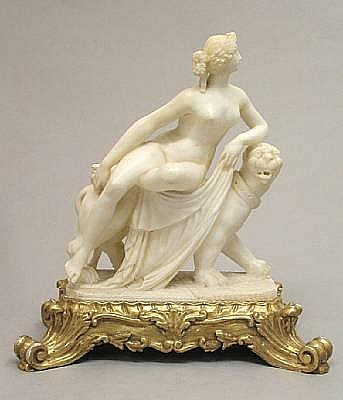 An Italian carved alabaster and gilt wood figural group of Ariadne and the panther