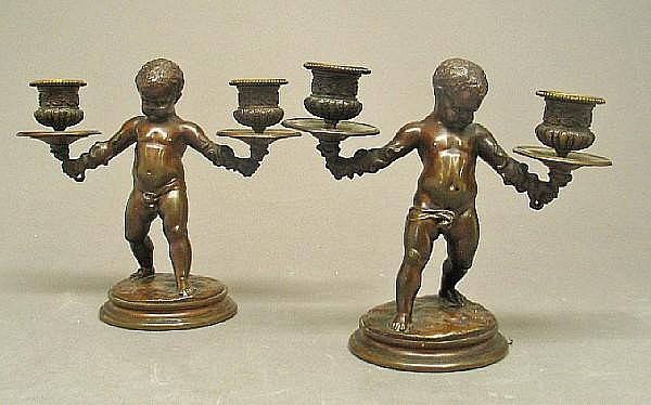 A pair of French patinated bronze figural two light candelabra after a model by Louis Kley (France 1833-1911)