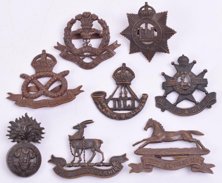 Eight British Officers Bronze Cap Badges