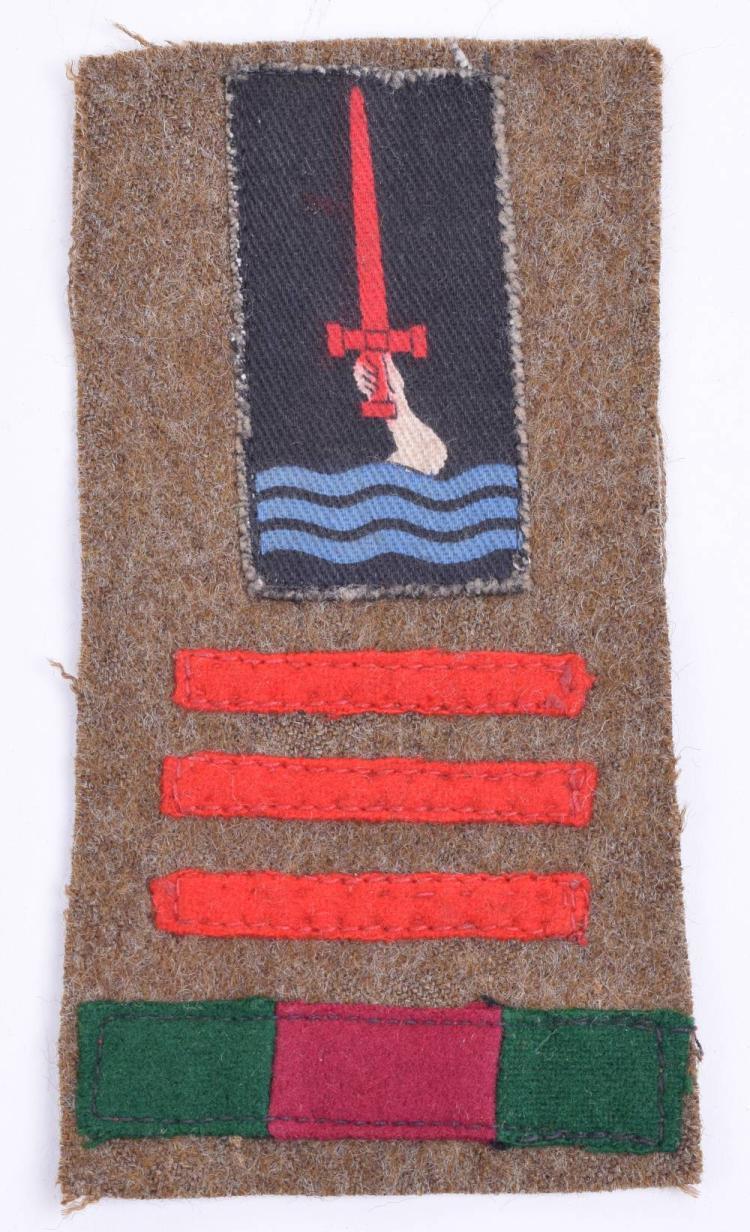 WW2 77th Division 211th Brigade 11th Battalion Devonshire Regiment Battle Dress Combination Insignia
