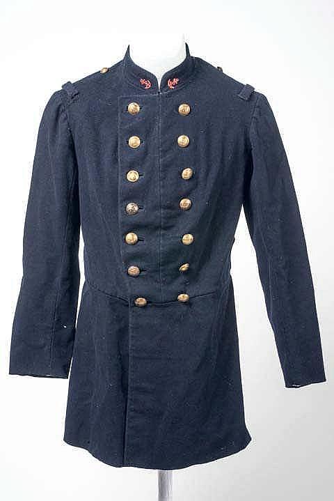 Veste troupe de l'Infanterie Coloniale en drap bleu foncé, insignes métalli