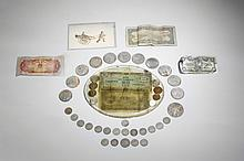 A GROUP OF VINTAGE COINS AND PAPER CURRENCIES