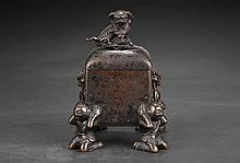 A BRONZE FOUR-LEG TWO-HANDLED SQUARE CENSER