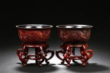 A PAIR OF CINNABAR LACQUER DRAGON BOWL WITH STAND