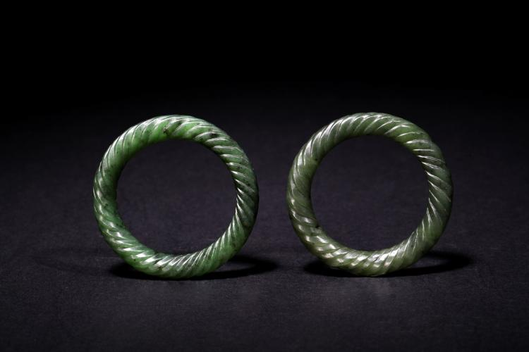 A PAIR OF SMALL GREEN JADE BANGLES