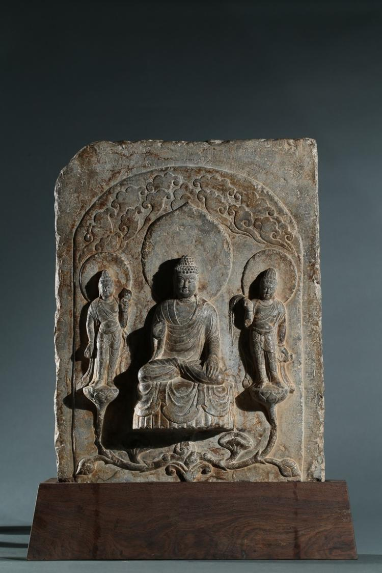 A STONE RELIEF PANEL OF SHAKYAMUNI AND ATTENDANTS