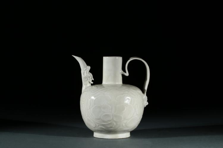 A DING-TYPE FLOWER CARVED EWER