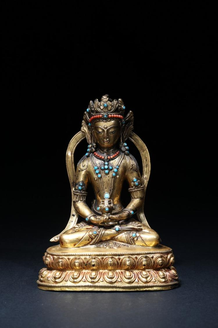 A GILT-BRONZE FIGURE OF AMITAYUS
