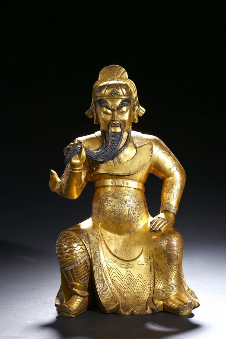 A GILT-BRONZE STATUE OF GUANDI