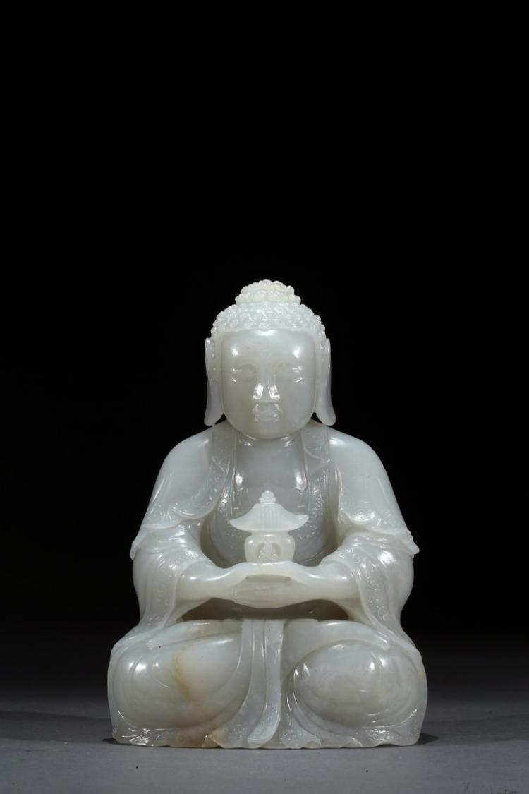 A WHITE JADE CARVED FIGURE OF AMITAYUS