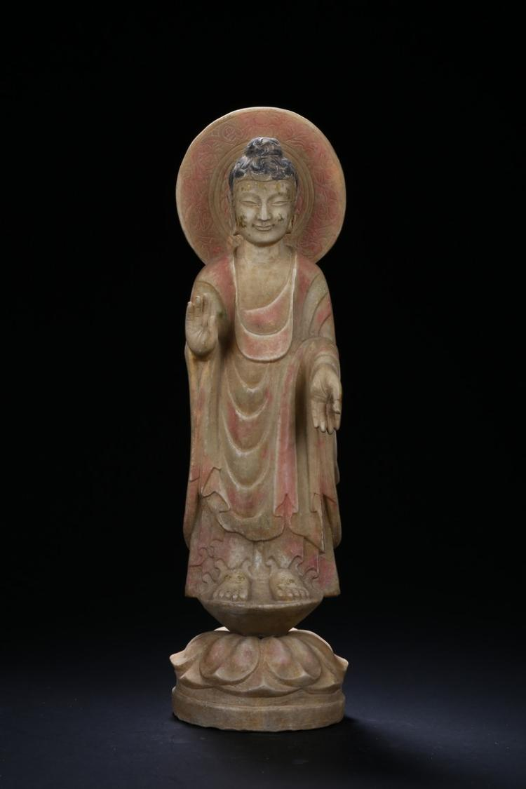 A STONE CARVED STANDING BODHISATTVA