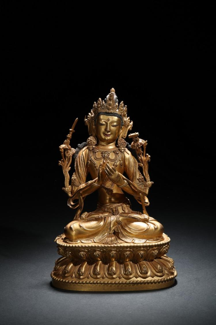 A GILT-BRONZE FIGURE OF MANJUSRI