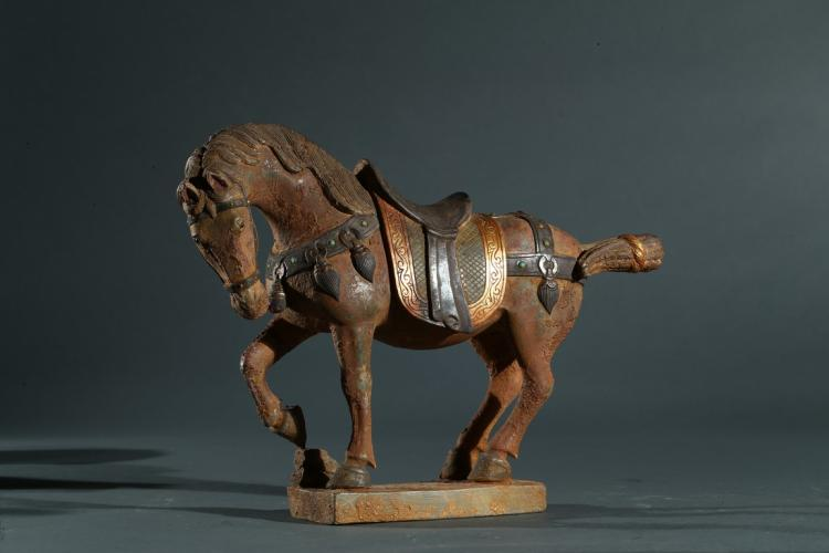 A STONE CARVED GILT SILVER INLAID HORSE