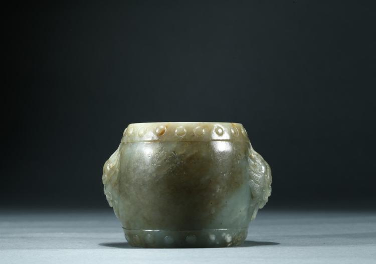 A CELADON JADE CARVED 'DRUM' PAPER WEIGHT