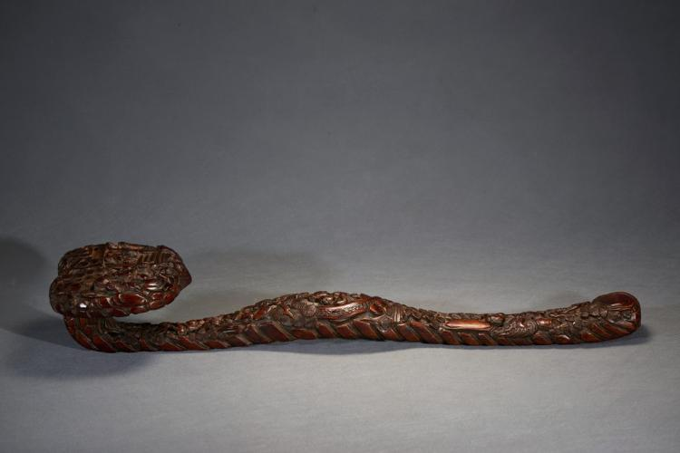 A VERY LARGE CARVED FIGURES RUYI SCEPTER
