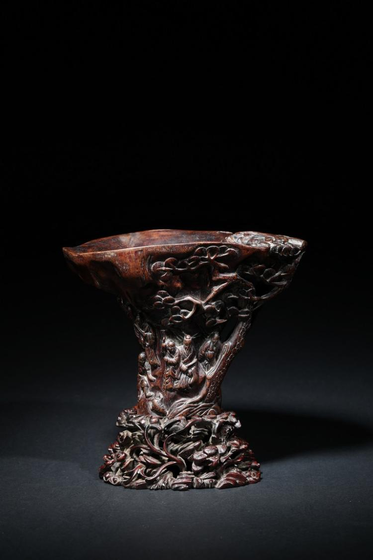 AN AGARWOOD CARVED 'FIGURES' LIBATION CUP