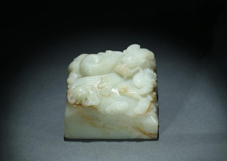 A WHITE JADE 'DRAGON' PAPER WEIGHT