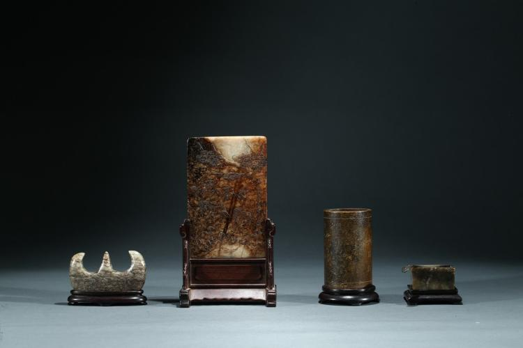 A SET OF FOUR JADE SCHOLAR OBJECTS