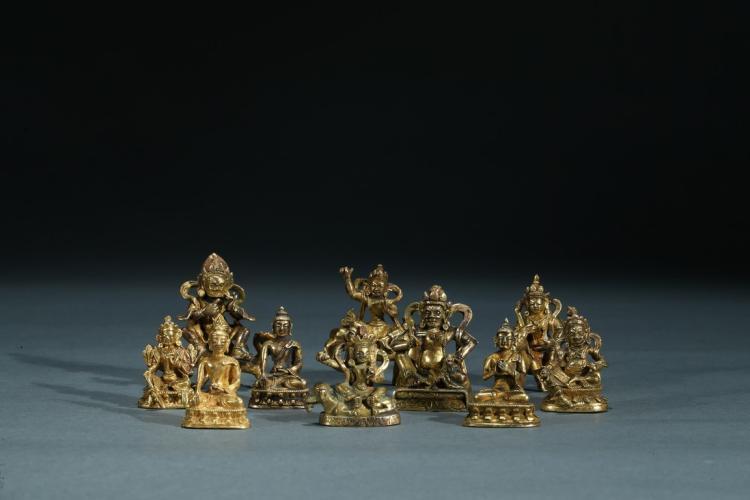 A GROUP OF TEN SMALL GILT BRONZE BODHISATTVA