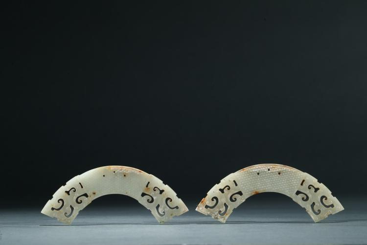 A PAIR OF ARCHAIC WHITE JADE HUANG