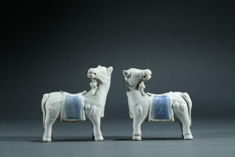 A PAIR OF WHITE AND BLUE GLAZE HORSES