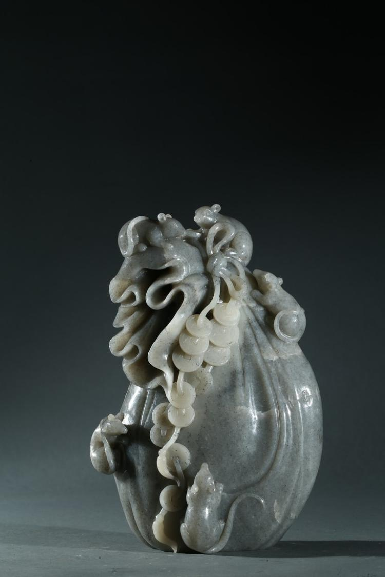 A GREY JADE CARVING OF COIN BAG
