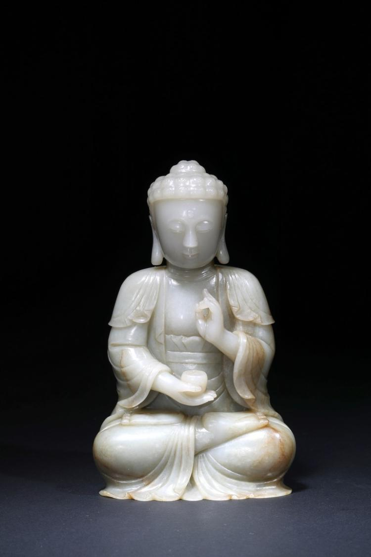 A WHITE JADE CARVED FIGURE OF BODHISATTVA