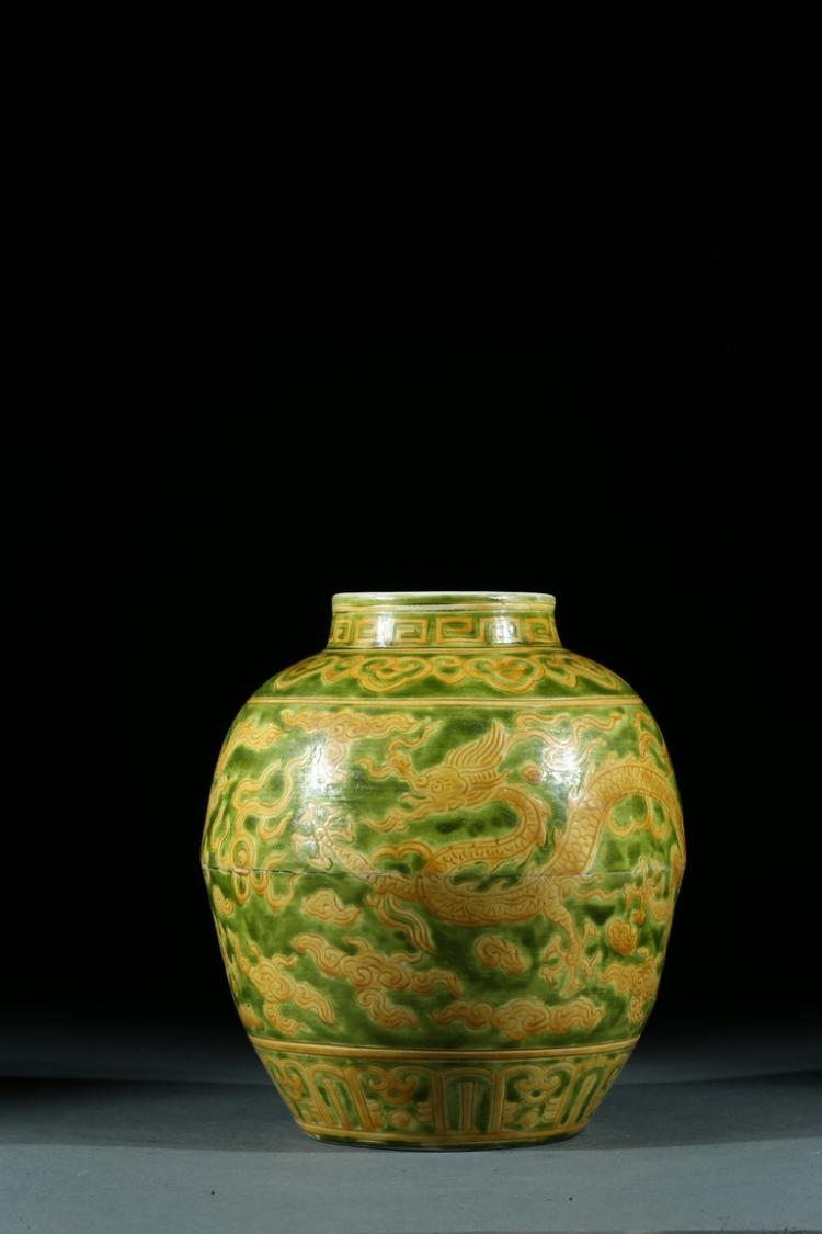 A GREEN GROUND YELLOW ENAMELLED 'DRAGON' JAR