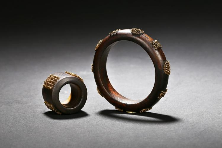A SET OF AGARWOOD BANGLE AND ARCHER'S RING